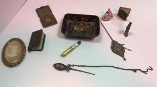 A collection of various objets de vertu, including photograph frames, spike spoons,