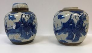 Two large Chinese blue and white decorated ginger jars decorated with figures in a garden setting,