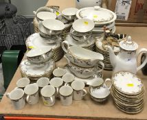 """A Royal Doulton """"Lynnewood"""" part dinner service comprising three tureens with lids,"""