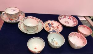 Three 19th Century polychrome decorated tea bowls and saucers,