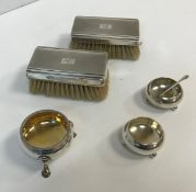 A pair of Victorian silver open salts of plain circular form,