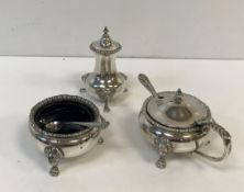 An Elizabeth II three piece cruet with gadrooned rims, raised on lion mask and paw feet,