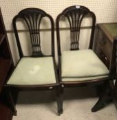 A set of eight 19th Century mahogany dining chairs in the Hepplewhite manner,