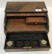 A 19th Century mahogany tambour top travelling writing case with basic fitted drawer containing two