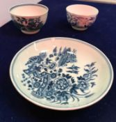 An 18th Century Worcester blue and white saucer decorated with two birds in flight and fence
