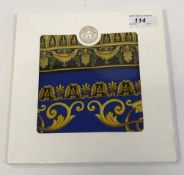 A Gianni Versace silk scarf in blue and gold signed Atelier Versace,