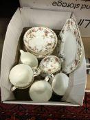 """A box containing a Minton """"Ancestral"""" tea service,"""