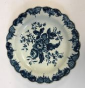 An 18th Century Worcester fruit and hop pattern dish with scalloped edge, 17.