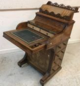 A Victorian burr walnut piano front Davenport with pop-up stationery compartment over a fitted