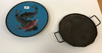 A circa 1900 Chinese cloisonne circular dish decorated with three carp on a pale blue background,