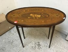 An Edwardian mahoghany and marquetry inlaid elongated oval tray,