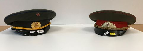 Two Russian military peaked caps,
