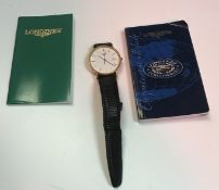 A Longines gold electro-plated wristwatch of slim design,