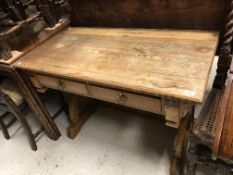 A late Victorian Aesthetic oak and inlaid writing table in the style of Godwin,