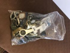 A bag containing 24 various watches, including Swatch, Select, imitation Omega, Solo, Crown,