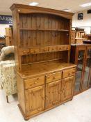 A modern pine dresser, 121 cm wide x 43 cm deep x 186 cm high,
