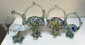 Three boxes of assorted glassware to include Murano style baskets, various vases,