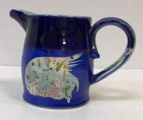 A Martina O'Leary fish decorated jug, designed by Roger Mitchell, signed to base, 12.