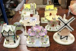 """A collection of nine Coalport cottage ornaments, including """"The Old Curiosity Shop"""","""