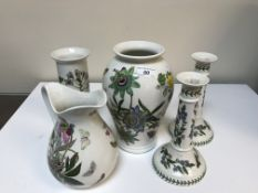 A collection of Portmerion botanic garden china to include salad bowls, vases, pair of candlesticks,