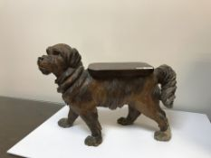 A black forest low stool in the form of a dog set with glass eyes,