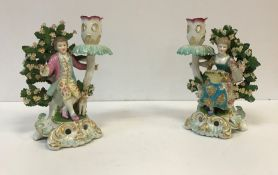 A pair of Samson bocage figural candlest