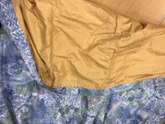 A pair of cotton Designer's Guild garden design blue and green interlined curtains with fixed
