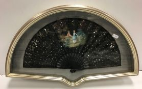 A late 19th Century fan, the net leaf painted with couple in a garden and decorated with sequins,