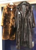 """A dark brown mink full length coat with satin lining and inscribed """"Julia"""" to the inside pocket,"""
