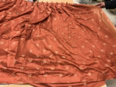 Two pairs of cotton mix terracotta ground interlined curtains, with gold C scrolling decoration,