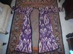 An Uzbekistan Chapan of purple colour Ikat