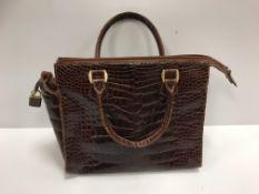 A Fratelli Rossetti brown crocodile skin handbag,