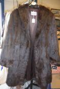 A vintage brown mink coat bearing Luxurstyle label to inside,