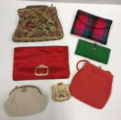 A collection of evening bags to include two beaded examples and an Austrian tapestry example