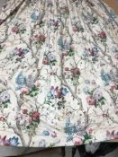 A pair of glazed cotton cream, pink and blue floral, lilac and rose decorated interlined curtains,