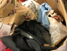 A box containing assorted table linens,