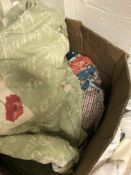A box of various curtains and clothing,