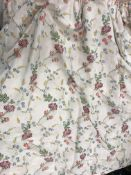A pair of silk style cream ground multi-coloured floral decorated interlined curtains with taped