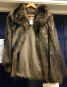 """A fur jacket bearing """"Brahams Furriers"""" label to the interior,"""