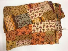 A Neeru Kumar quilted throw in a brown,