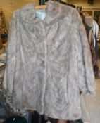 A brown mink jacket with satin lining, t