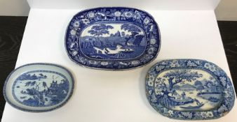 An oval porcelain dish decorated with coastal dwelling and figures in a punt, 26 cm x 19 cm, a