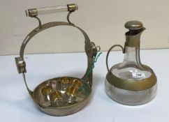A mid 20th Century glass and plated mounted Vodka tantalus with onion shaped jug and lockable stand,