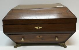 A late Georgian mahogany work box of sarcophagus form, the rising top over a single drawer on