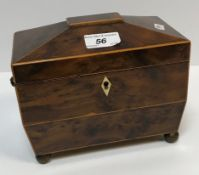 An early 19th Century burr yew veneered and box wood strung two section tea caddy of sarcophagus