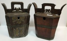 A Chinese painted faux rosewood food box of tapered form with locking handle over a carved and