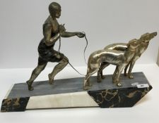 """An Art Deco design silvered and patinated figure group as """"A woman in fan decorated dress, barefoot,"""