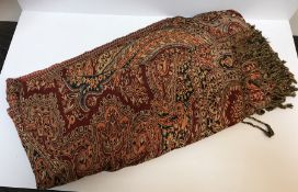 A modern Paisley design red ground shawl / table cover, 432 cm x 500 cm approx