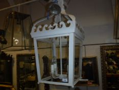 A modern painted metal and glass hall lantern of square tapering form with acanthus leaf style