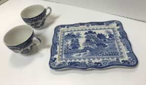 """A box containing a collection of blue and white """"Willow"""" pattern china, a modern decorative fire"""